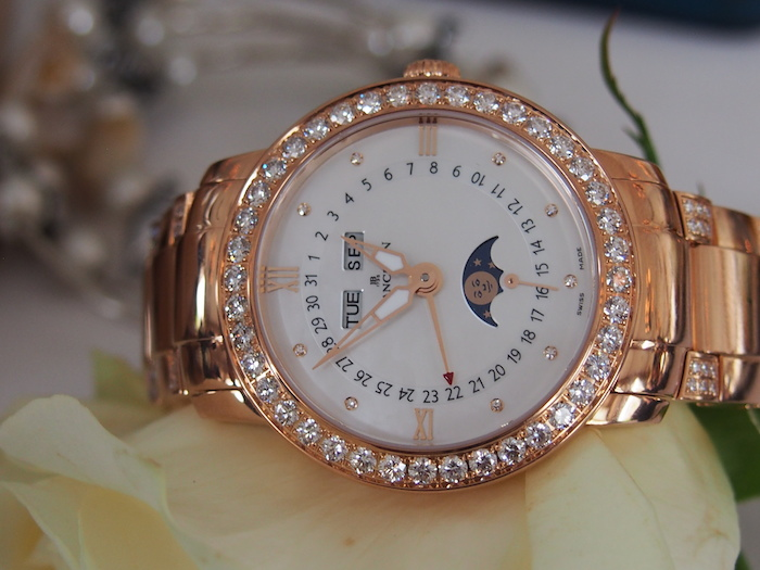 This diamond calendar watch with moon phase is crafted in 18-karat rose gold.