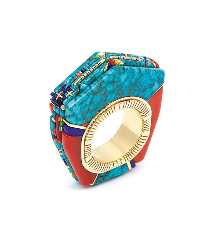 Ring by Raymond Yazzie is made from two types of native turquoise, opal and sugilite and set in 14-karat gold.