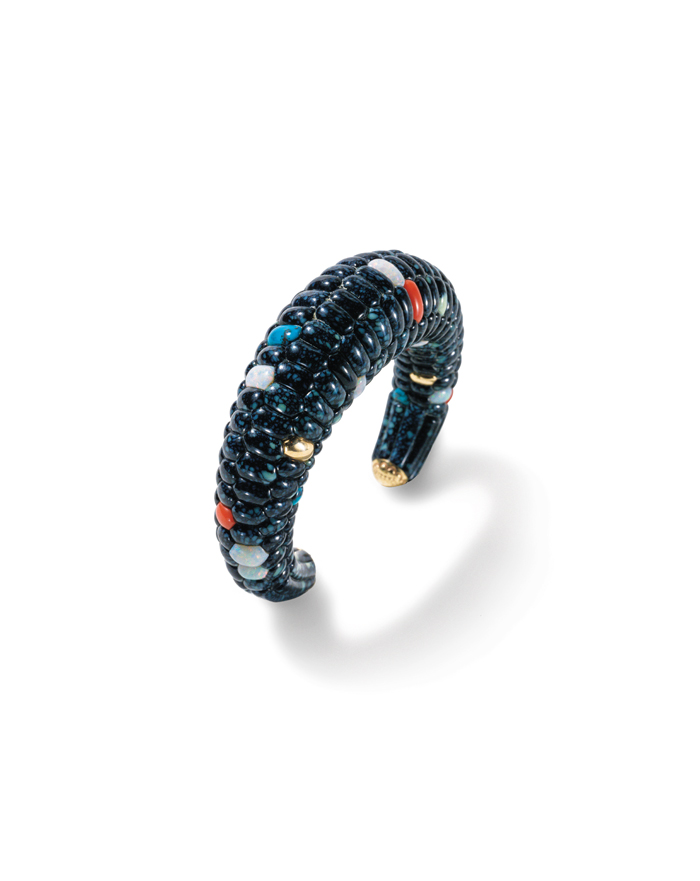 Blue corn bracelet by Lee Yazzie is constructed with hidden bracework that anchors the turquoise, opal, lapis and coral gemstone kernels.