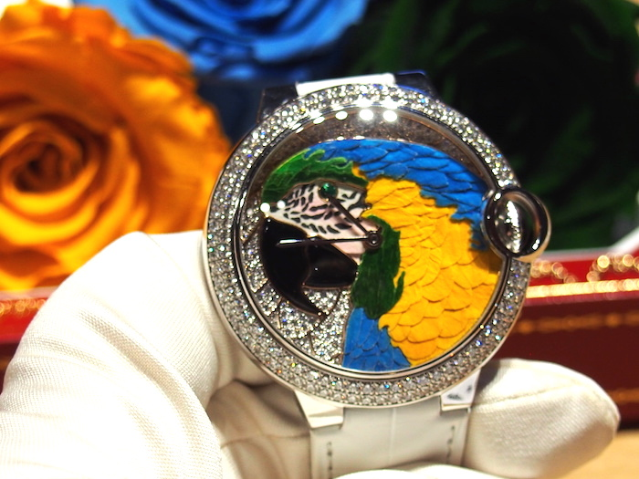At SIHH in 2014, Cartier unveiled the Ballon Bleu watch whose parrot dial is made of rose petals.
